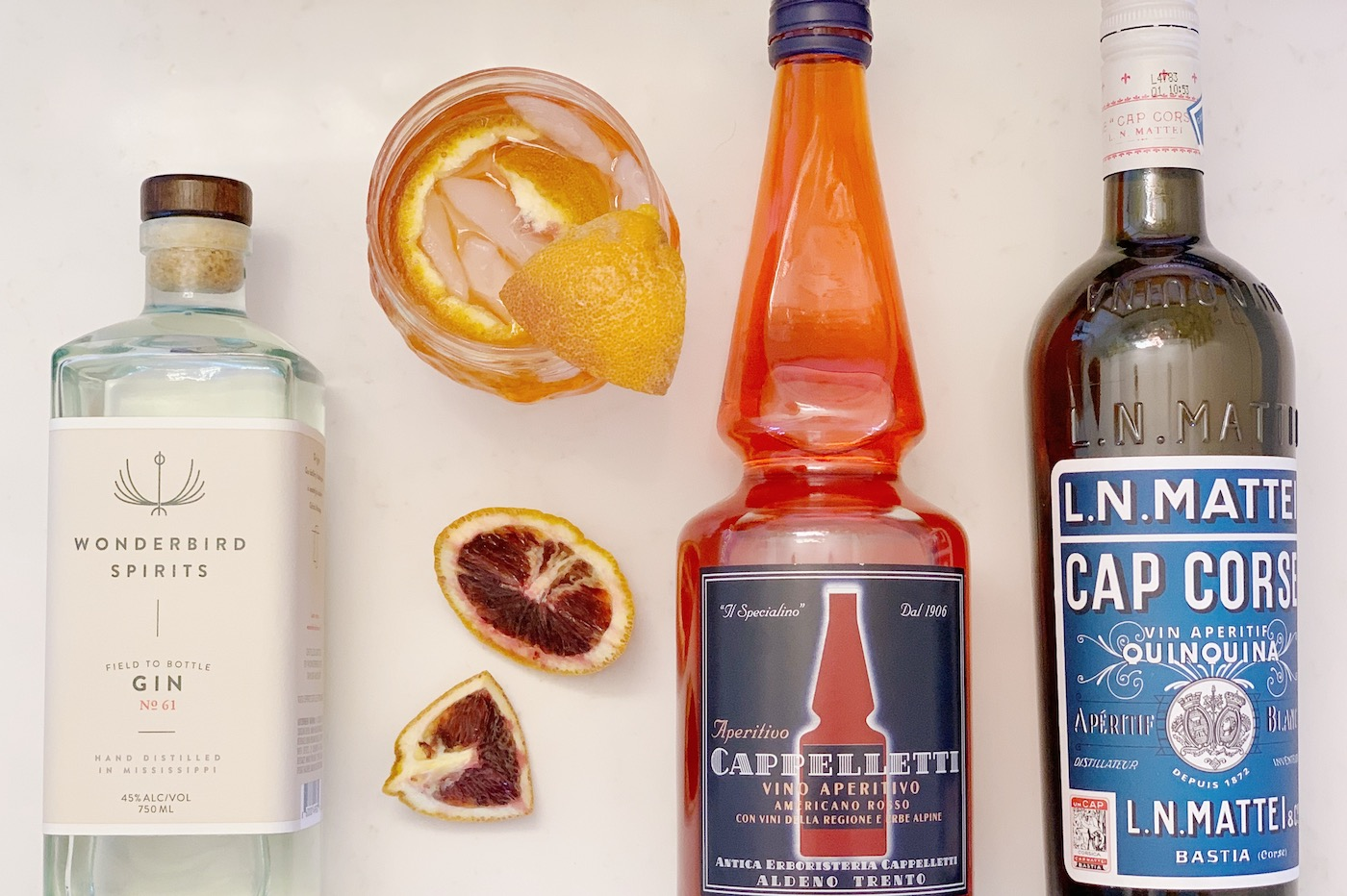 The New Negroni made with Wonderbird Gin, Cappelletti, and Cap Corse
