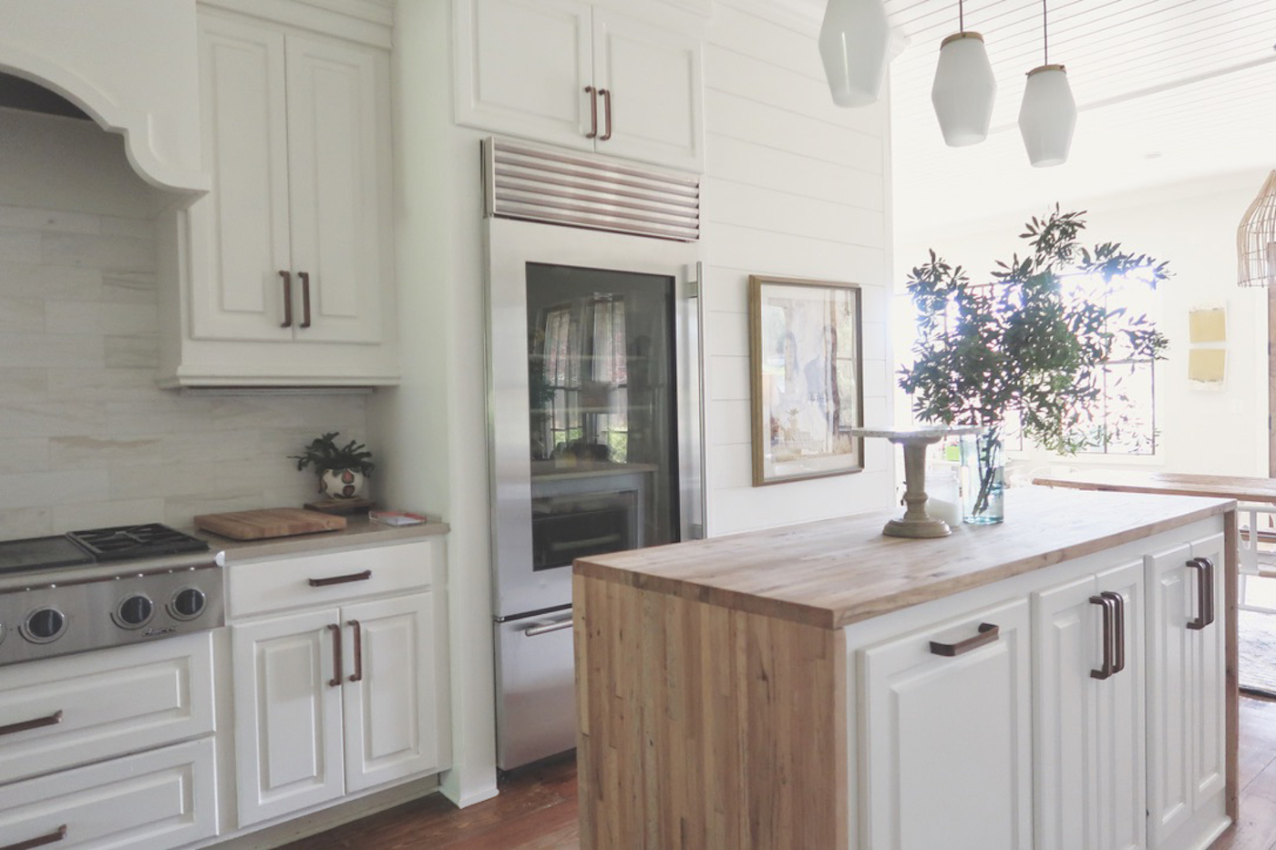 Kitchen Renovation // BEFORE AND AFTER // New quartz countertops, wooden hardware, reclaimed butcher block waterfall island